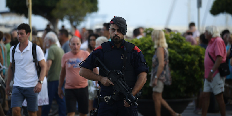 Mossos d'Esquadra regional police officers patrol during a rally to commemorate those killed in the recent attacks in Barcelona, in Cambrils, Spain, Friday, Aug. 25, 2017. The Islamic State group has claimed responsibility for the attacks on Aug. 17-18 in Barcelona and Cambrils that left 15 dead and more than 120 injured. Eight suspects are dead and four more under investigation, two of them in jail. (AP Photo/Manu Fernandez)